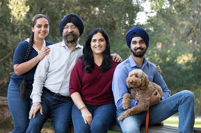 Savi's family includes (from left to right) his daughter Simran, wife Chetna, son Amrit, and their goldendoodle, James.
