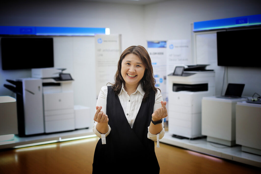 Soohee, Director for HP Print Harware Systems, smiles to the camera.
